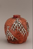 view Faceted candy-pellet bottle with design of drying nets, unkown Raku ware workshop digital asset number 1