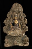 view Seated Buddhist figure: in round, against pierced rock grotto background; right hand broken off and restored in wood digital asset number 1
