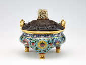 """view Incense burner in shape of a tripod (li) with design of lotus and with three kinds of fruit (the """"three plenties"""") on the underside of vessel digital asset number 1"""