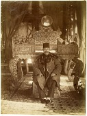 view Nasir al-Din Shah Sitting on the Lower Step of Takht-i Tavoos (Peacock Throne), in the Talar-i Takht (Throne Room) at Kakh-i Gulistan (Gulistan Palace Complex), Tehran (Iran) digital asset: Jay A. Bisno Collection of Sevruguin Photographs