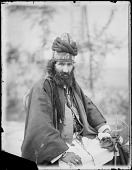 view Studio Portrait: Seated Dervish Holding Engraved Axe [graphic] digital asset number 1