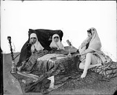 view Three Persian Women Seated around a Kursi [graphic] digital asset number 1