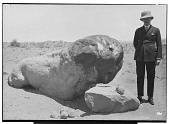 view Hamadan (Iran): Battered Sculpture of a Legless, Couchant Lion Carved Out of Yellow Sandstone [graphic] digital asset number 1