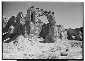 """view Excavation of Kuh-e Khwaja (Iran): Ruins of Ghaga-Shahr, """"Palace-Temple"""" Complex, First Room of South Gate: View of Thin Arch with Remnants of Crenellations digital asset: Excavation of Kuh-e Khwaja (Iran): Ruins of Ghaga-Shahr, """"Palace-Temple"""" Complex, First Room of South Gate: View of Thin Arch with Remnants of Crenellations [graphic]"""