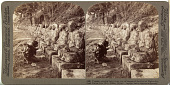 view (40) Peasant praying before long row of images of the God of light - So. bank Daiya river (E.) , Nikko, Japan digital asset: (40) Peasant praying before long row of images of the God of light - So. bank Daiya river (E.) , Nikko, Japan, [graphic]