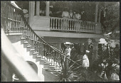 view Hawaii: Alice Roosevelt ascending staircase with Governor Atkinson digital asset: Hawaii: Alice Roosevelt ascending staircase with Governor Atkinson