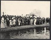view Kobe: Japanese line the dock, holding US flags, waving goodbye to U.S delegation members. July 30, 1905 digital asset number 1