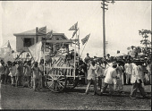 view Iloilo City: Parade of a wagon displaying iron tools. August 14-15, 1905 digital asset number 1
