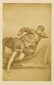 view Arpee Album: Photograph of a Reclining Woman digital asset: Arpee Album: Photograph of a Reclining Woman [graphic]