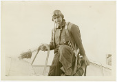view General Benjamin Kelsey Scrapbooks digital asset: Benjamin S. Kelsey seated on the edge of the cockpit of a Curtiss P-36A Hawk (Hawk 75L)  at Buffalo, New York, following his flight from Wright Field, Dayton, Ohio.: October 26, 1938
