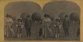 view Untitled. Woman and children post for their photograph in front of three large gas balloons digital asset: Untitled. Woman and children post for their photograph in front of three large gas balloons