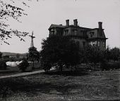 view Obscured view of Gates Mansion at Carl Myers' Balloon Farm with what appear to be U.S. Army Signal Service balloons and windmill in background. digital asset: Obscured view of Gates Mansion at Carl Myers' Balloon Farm with what appear to be U.S. Army Signal Service balloons and windmill in background.