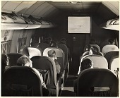view Boeing Model S-307 (PAA-307) Stratoliner, Interior, Passenger Cabin, In-Flight Movie; Pan American Airways (PAA). [photograph] digital asset number 1