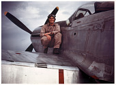 view Frederick J. Poats Color Photography Collection digital asset: Pilot poses on wing of North American P-51 Mustang