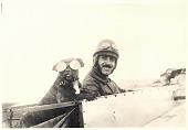 "view Shakir S. Jerwan Scrapbooks digital asset: Shakir Jerwan and his dog ""Monoplane"" (NASM 91-19563). Shakir S. Jerwan Scrapbooks Collection, NASM.XXX.0231"