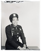 view Studio Portrait of a Woman Sitting Wearing a Military Uniform digital asset number 1