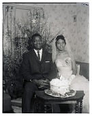 view Indoor Portrait of the Bride and Groom Sitting with the Wedding Cake digital asset number 1