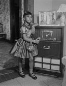view Indoor Portrait of a Child Leaning against a Radio, Ruby Washington digital asset number 1