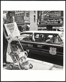 view <I>William Edwin Jones pushes daughter Renee Andrewnetta Jones (8 months old) during protest march on Main St. in Memphis Tennessee.</I> digital asset number 1