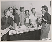 view Photograph of seven Junior NCNW members with voter information pamphlets digital asset number 1