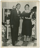 view Photograph of Joel and Mae Reeves in Mae's Millinery Shop digital asset number 1