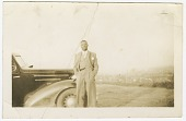 view Photograph of an unidentified man in front of car digital asset number 1