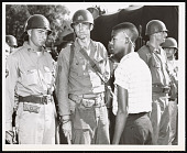 view Photograph of Terrence Roberts and soldiers at Little Rock Central High School digital asset number 1