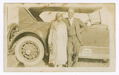 view Photograph of a man and woman in front of car digital asset number 1