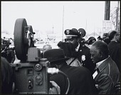 view <I>Coretta Scott King is being protected by police officers and civil rights workers as she leaves Ebenezer Baptist Church</I> digital asset number 1
