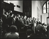 view <I>Rev. E.W. Lumpkin conducts the Interdenominational Theological Center male chorus</I> digital asset number 1