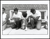 view <I>Cairo, Illinois. SNCC Field Secretary, Later SNCC Chairman, Now Congressman John Lewis, and Others Pray During a Demonstration</I> digital asset number 1