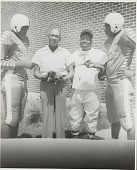 view Group portrait of MVC football players with J.H. White and Coach McPherson digital asset number 1