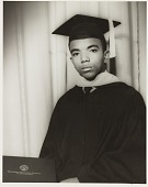 view Studio portrait of a man in graduation cap and gown digital asset number 1