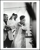 """view <I>Rev. Gina M. Stewart, pastor of Christ MBC, moves the congregation during her """"Resurrection Sunday"""" message, Memphis, Tennessee, 2005</I> digital asset number 1"""