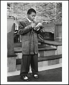 view <I>A sharply dressed young boy reads his Easter speech at New Jerusalem Temple Bible Way Church, Washington, D.C. 2004</I> digital asset number 1