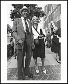 view <I>An elderly couple departs Sunday morning services at Metropolitan AME Church, Washington, D.C., 1997</I> digital asset number 1