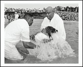 view <I>A more than 40 year old tradition of baptizing in the Chesapeake Bay at Taylor's Beach is continued every 3rd Sunday in August by Rev. T. Wright Morris (right), pastor of Shiloh Baptist Church, Reedville, Virginia, 2003</I> digital asset number 1