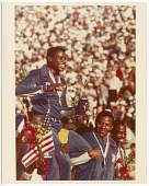 view Photograph of Carl Lewis with his fourth gold medal at the Los Angeles Olympics digital asset number 1