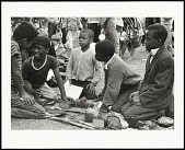view <I>Children cutting bread which was brought to the Free Huey Rally by the Diggers, De Fremery Park, Oakland, CA, No. 35</I> digital asset number 1