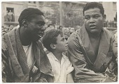 view Photographic print of Joe Louis with an unidentified man and boy digital asset number 1