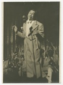 view Print of Cab Calloway in checked suit standing in front of microphone digital asset number 1