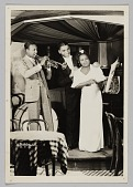 view Photograph of Paul Brown and a woman standing next to a trumpet player digital asset number 1