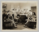 view Film still of a group of people gathered around a piano digital asset number 1