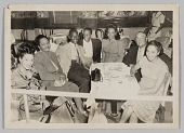"view Photograph of Bill ""Bojangles"" Robinson seated with a group at a table digital asset number 1"