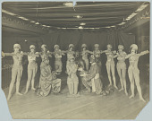 view Photograph of two men and eleven women posing in stage costumes digital asset number 1