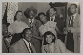 view Photograph of Laura Cathrell and a group of men and women at a party digital asset number 1