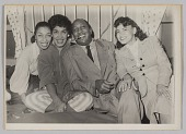 view Photograph of a Laura Cathrell, a man, and two women at a party digital asset number 1