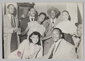 view Photograph of a Laura Cathrell and a group of men and women at a party digital asset number 1
