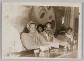 view Photograph of Birdie Warfield Edison an unidentified man seated at a bar digital asset number 1