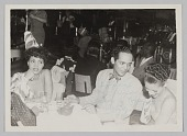 view Photograph of a man and two female performers seated at a table at Club 845 digital asset number 1